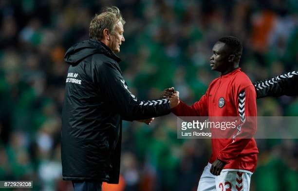 Age Hareide, head coach of Denmark shake hands with Pione Sisto of Denmark after the FIFA 2018 World Cup Qualifier Play-Off First Leg match between...