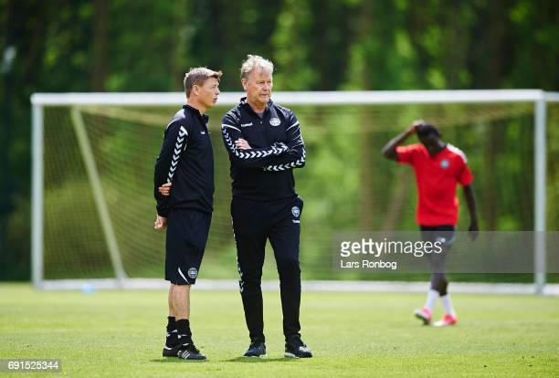 Age Hareide head coach of Denmark speaking to Jon Dahl Tomasson during the Denmark training session at Brondby Stadion on June 2 2017 in Brondby...