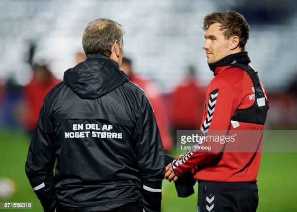 Age Hareide head coach of Denmark speaks to Andreas Bjelland during the Denmark training session at Helsingor Stadion on November 7 2017 in Helsingor...