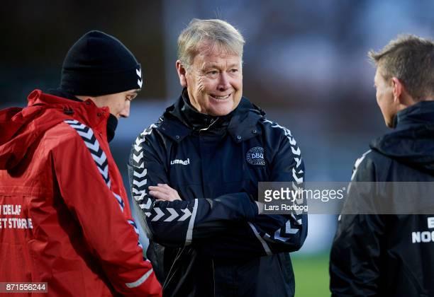Age Hareide head coach of Denmark speaks to Andreas Christensen during the Denmark training session at Helsingor Stadion on November 7 2017 in...