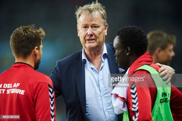 Age Hareide head coach of Denmark speaks to Andrew Hjulsager and Pione Sisto of Denmark after the international friendly match between Denmark and...