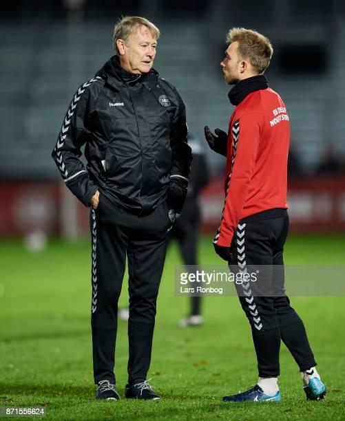 Age Hareide head coach of Denmark speaks to Christian Eriksen during the Denmark training session at Helsingor Stadion on November 7 2017 in...