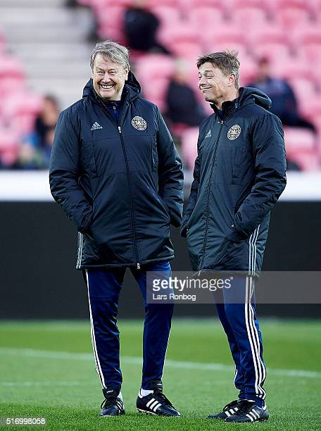 Age Hareide head coach of Denmark speaks to Jon Dahl Thomasson assistant coach of Denmark during the Denmark training session at MCH Arena on March...