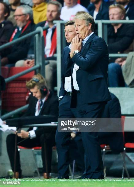 Age Hareide head coach of Denmark speaks to Jon Dahl Tomasson assistant coach of Denmark during the FIFA World Cup 2018 qualifier match between...