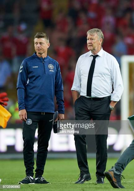 Age Hareide head coach of Denmark speaks to Jon Dahl Tomasson assistant coach of Denmark after the international friendly match between Denmark and...
