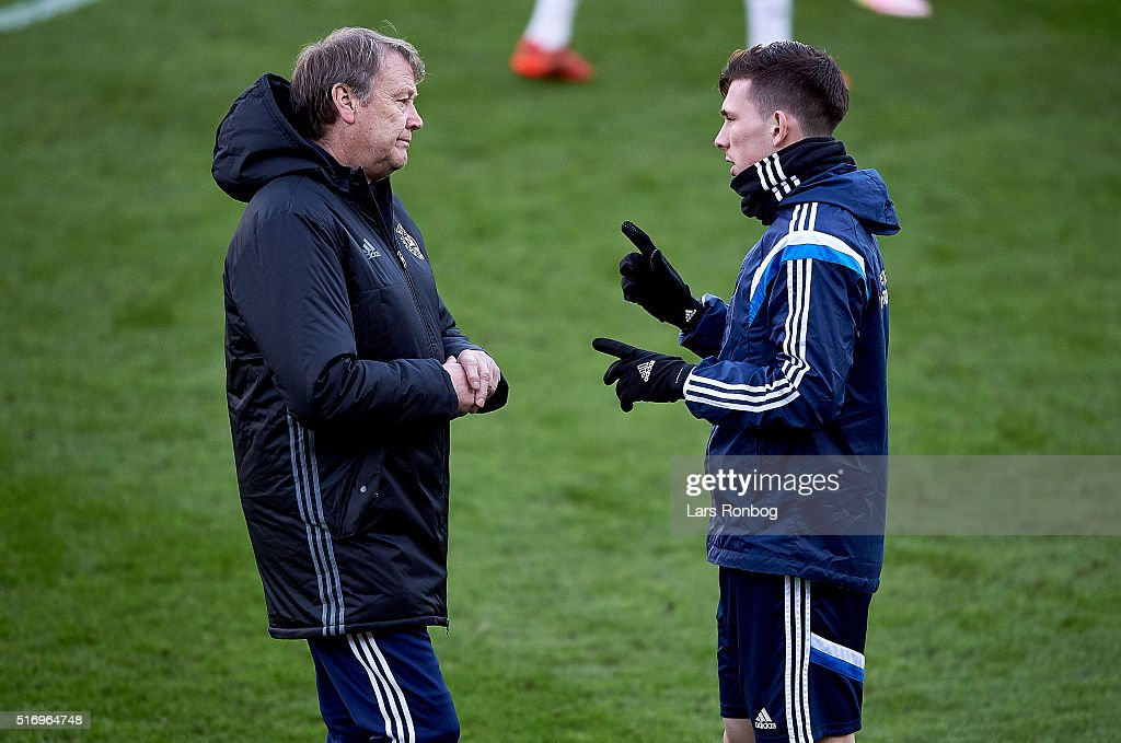Age Hareide, head coach of Denmark speaks to Pierre Emile Hojbjerg during the Denmark training session at MCH Arena on March 22, 2016 in Herning, Denmark.