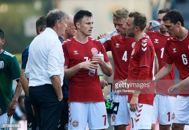 Age Hareide head coach of Denmark speaks to William Kvist of Denmark and Christian Eriksen of Denmark during the international friendly match between...