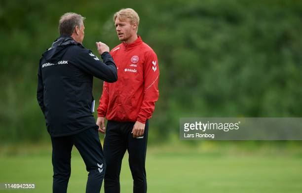Age Hareide head coach of Denmark talking to captain Simon Kjar during the Denmark training session at Brondby Stadion on May 30 2019 in Brondby...