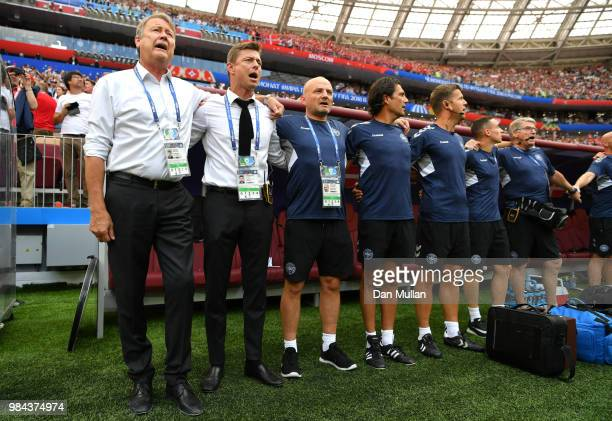 Age Hareide Manager of Denmark and assisstant John Dahl Tomasson sing the natopnal anthem prior to the 2018 FIFA World Cup Russia group C match...