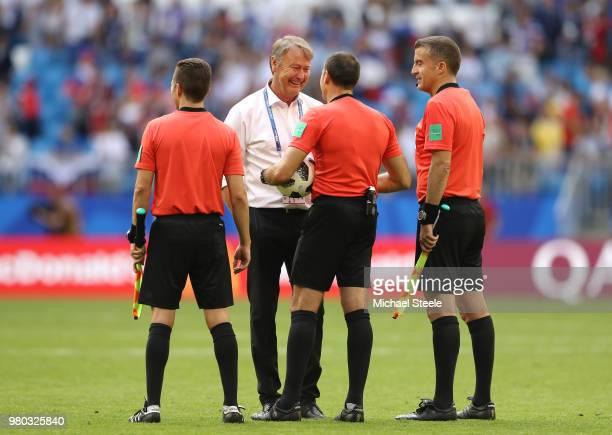 Age Hareide Manager of Denmark cheers Referee Antonio Mateu Lahoz and linesmen Roberto Diaz Perez Del Palomar and Pau Cebrian Devis during the 2018...
