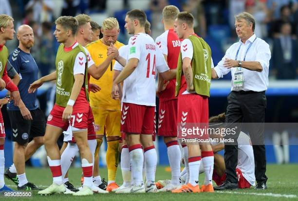 Age Hareide Manager of Denmark comforts players after the 2018 FIFA World Cup Russia Round of 16 match between Croatia and Denmark at Nizhny Novgorod...