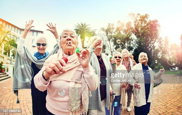 age is never a reason to stop having fun - fun stock pictures, royalty-free photos & images