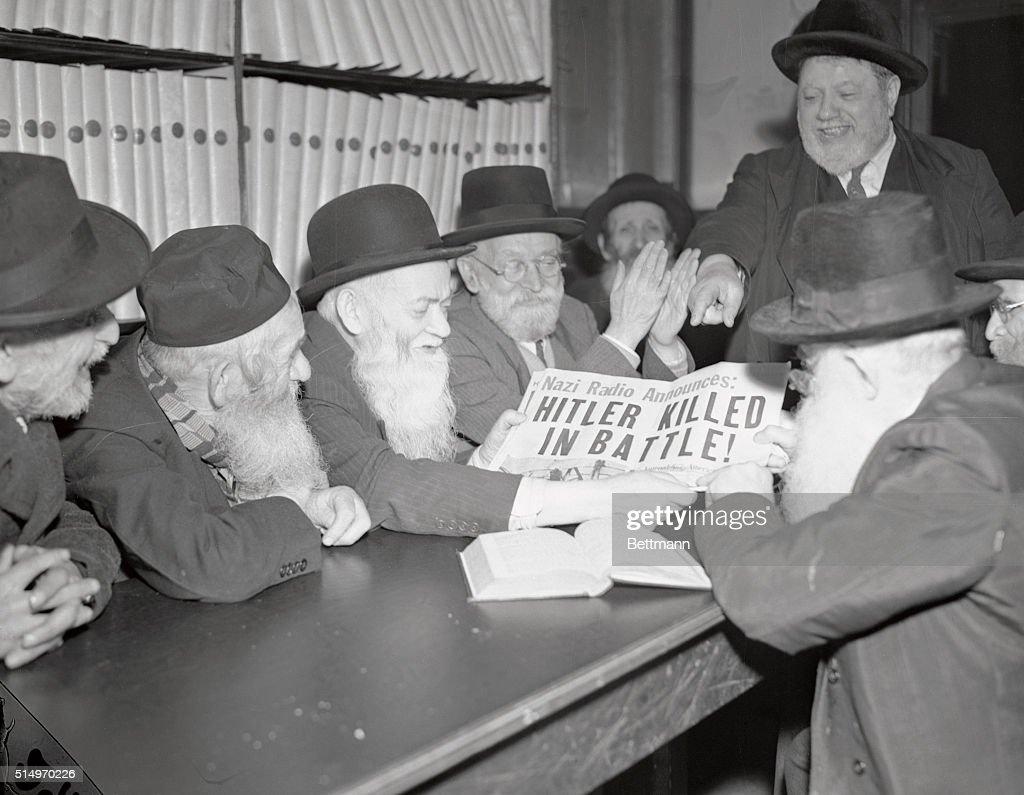 Jewish Elders Reading Headline of Hitler's Death : News Photo