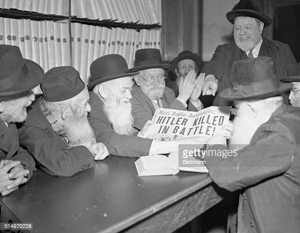 Aged Jewish students at the Home of the Sages of Israel, 268 East Broadway, New York, lay aside the Talmud temporarily as they read newspapers...