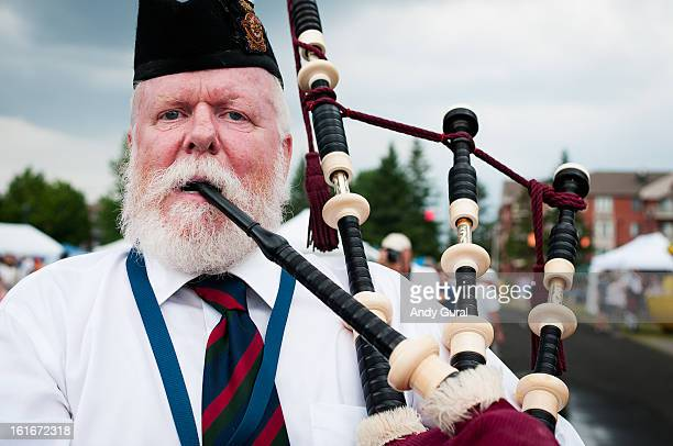 CONTENT] Aged male bagpiper in Glengarry hat playing the bagpipes The bearded bagpiper has white hair with a touch of ginger This photo was taken at...