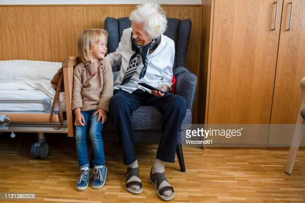 aged woman and her great-granddaughter having fun together - great granddaughter stock photos and pictures