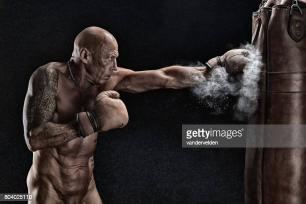 Ageing boxer training in the nude