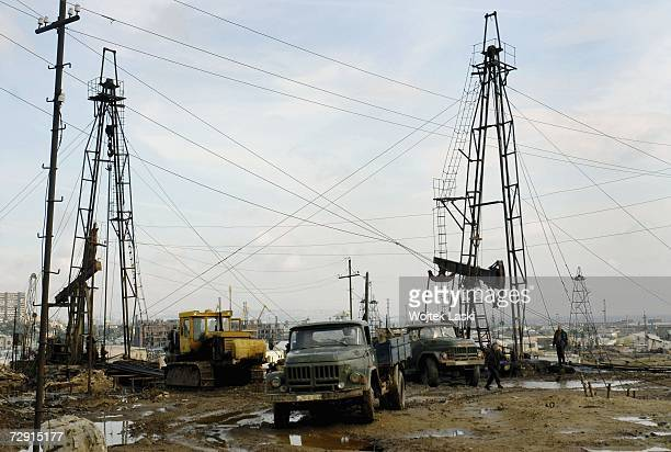 Ageing infrastructure, leaking crude oil and debris from decades of extraction, litter an oil field, October 26, 2006 in Baku, Azerbaijan. Oil-rich...