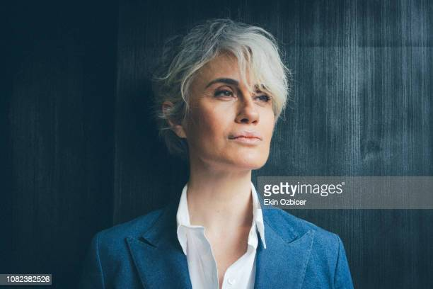 ageless woman in contemplative mood - capelli grigi foto e immagini stock