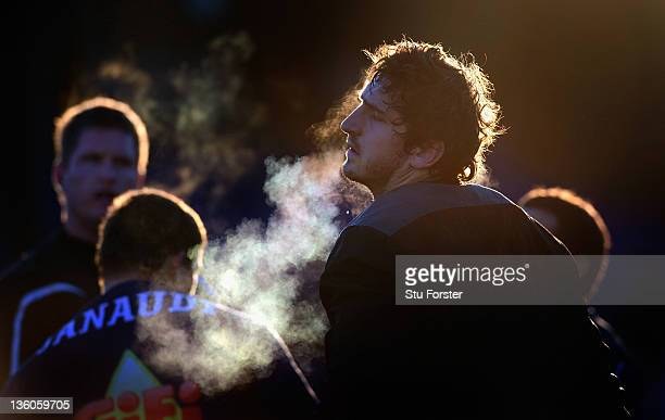 Agen forward Jerome Mondoulet warms up before the Amlin Challenge Cup match between Sale Sharks and Agen at Edgeley Park on December 18, 2011 in...