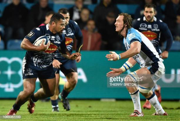 Agen player Paul Ngauamo face Montpellier player Jacques Du Plessis during the French Top 14 rugby union match between Agen and Montpellier on...