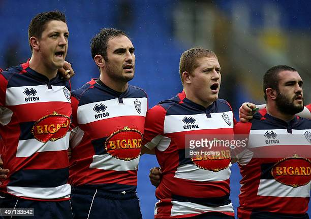 Agen players sing the French national anthem during a minute's silence in memory of the victims of the paris attacks ahead of the European Rugby...