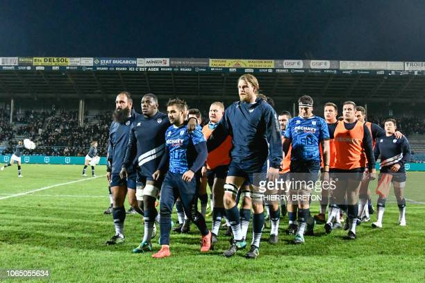 Agen players walk during the French Top 14 rugby union match between Agen and Montpellier on November 24 2018 at the Armandie Stadium in Agen...