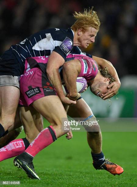 Agen win Branden Holder gets to grips with Henry Purdy of Gloucester during the European Rugby Challenge Cup match between Gloucester Rugby and Agen...