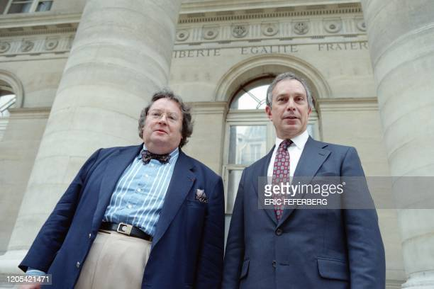 Agence France-Presse chairman and managing director, Jean Miot , and Michael Bloomberg, president and founder of Bloomberg L.P., pose for...