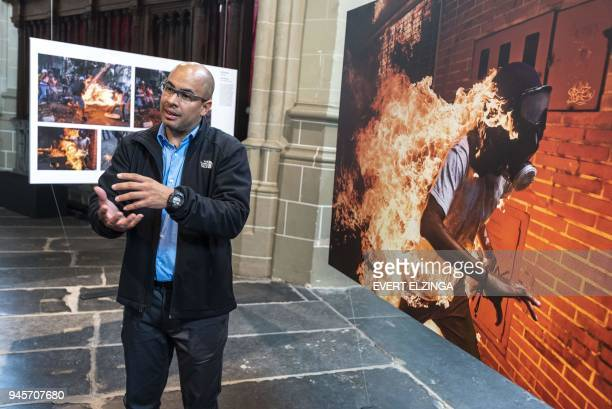 Agence FrancePresse photographer Ronaldo Schemidt winner of 2018 World Press Photo of the Year Award speaks during a photo presentation in Amsterdam...
