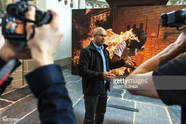 Agence FrancePresse photographer Ronaldo Schemidt winner of 2018 World Press Photo of the Year Award is pictured as he speaks during a photo...