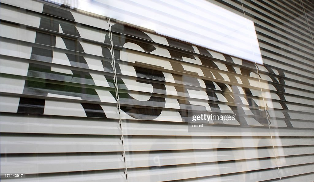 Agency text on the glass window : Stock Photo