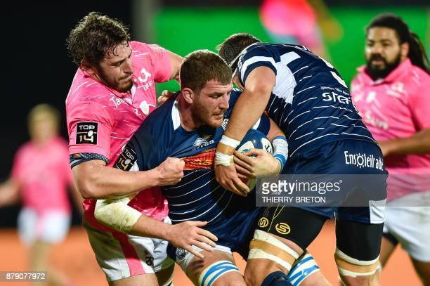 Agen's Antoine Erbani vies with a player from Stade Francais during the French Top 14 rugby union match between SU Agen and Stade Francais on...