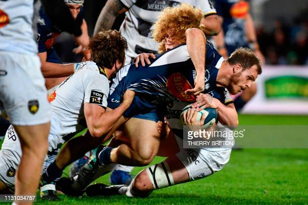 Agen's Argentine hooker Facundo Bosch tries to avoid a tackle during the French Top 14 rugby union match between SU Agen and La Rochelle on March 16...