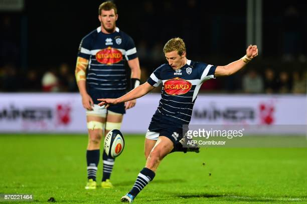 Agen's Australian flyhalf Jake Mc Intyre kicks the ball during the French Top 14 rugby union match between Agen and Toulon on November 4 2017 at the...