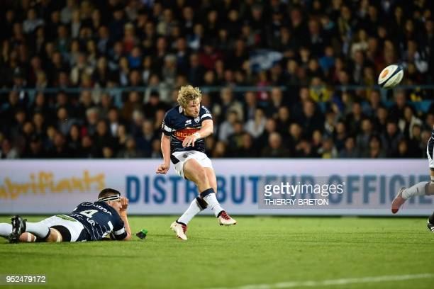 Agen's Australian flyhalf Jake Mc Intyre scores a penalty during the French Top 14 rugby union match between SU Agen and ASM Clermont on April 28...
