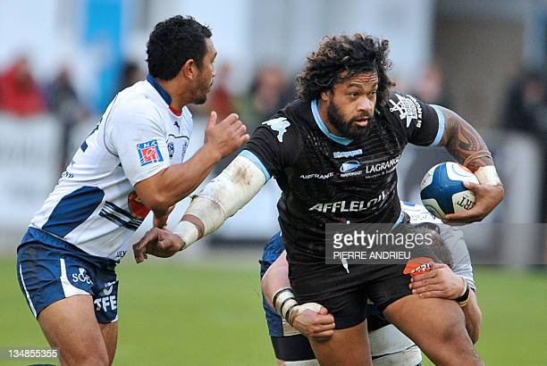 Agen's centre Junior Pelesasa collapses with Bayonne' number 8 Sione Lauaki during the French Top 14 rugby union match Agen vs Bayonne on December 4...