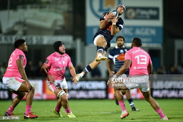 Agen's Clement Laporte catches the ball during the French Top 14 rugby union match between SU Agen and Stade Francais on November 25, 2017 at...