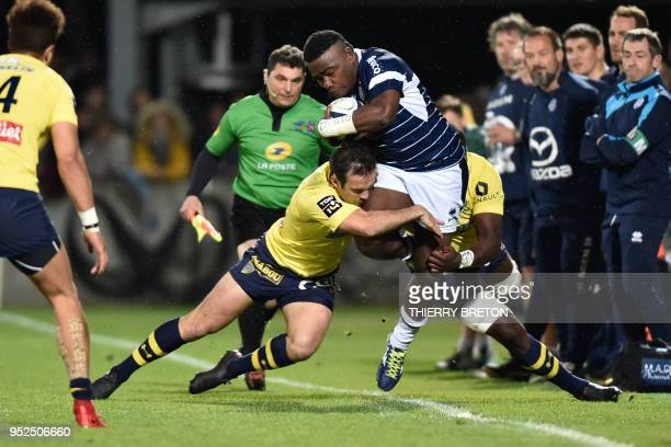 Agen's Fijian winger Filipo Nakosi is tackled by Clermont's scrumhalf Morgan Parra during the French Top 14 rugby union match between SU Agen and ASM...