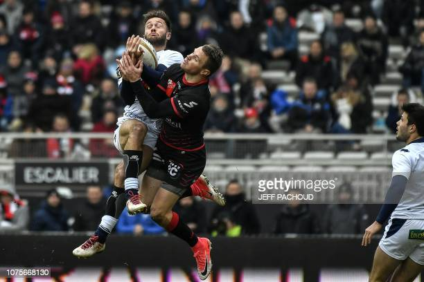Agen's French fullback Loris Tolot jumps for the ball with Lyon's Australian wing Toby Arnold during the French Top 14 rugby union match between Lyon...
