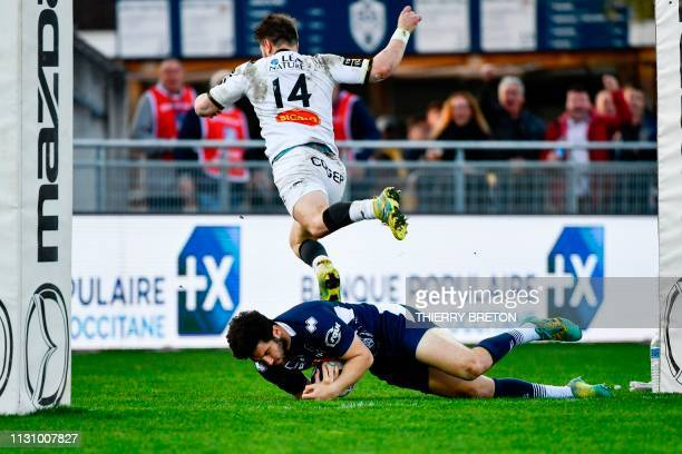 Agen's French fullback Mathieu Lamoulie scores a try during the French Top 14 rugby union match between SU Agen and La Rochelle on March 16th 2019 at...