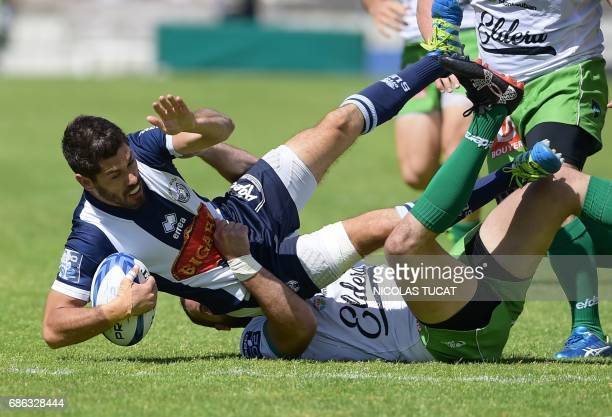 Agen's French scrum half Clement Darbo vies with Montauban's players during the French Pro D2 final rugby match between Montauban and Agen on May 21...