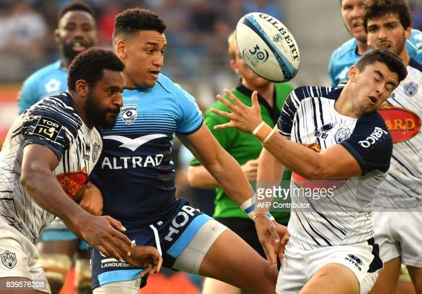 Agen's French scrumhalf Hugo Verdu and Agen's New Zealand wing George Tilsley fight for the ball with Montpellier's French centre Yvan Reilhac during...