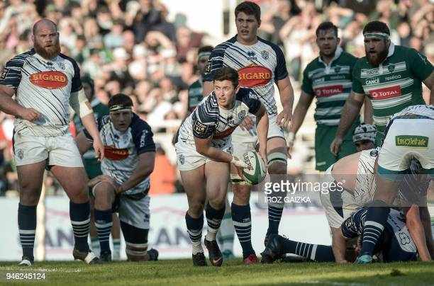 Agen's French scrumhalf Hugo Verdu passes the ball during the French Top 14 rugby union match between Pau and Agen at the Hameau stadium on April 14...
