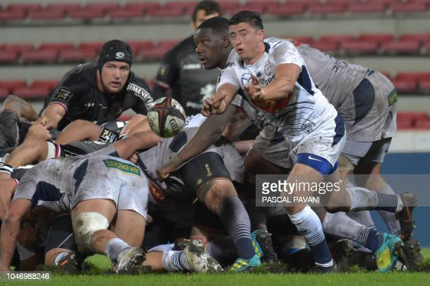 Agen's French scrumhalf Hugo Verdu passes the ball from a scrum during the French Top 14 rugby union match Toulouse against Agen October 6 2018 at...