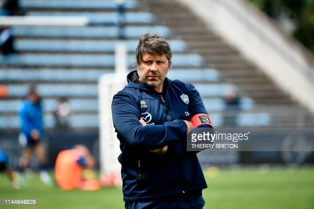 Agen's front coach Mauricio Reggiardo looks on prior to the French Top 14 rugby union match between SU Agen and Castres Olympique on May 18 2019 at...