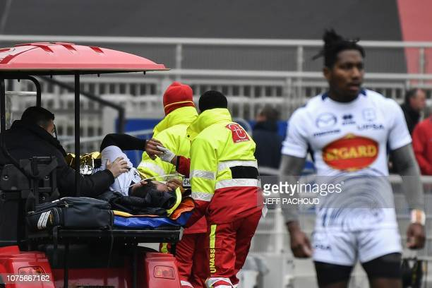 Agen's Georgian centre Tamaz Mchelidze is evacuated after being injured during during the French Top 14 rugby union match between Lyon and Agen on...