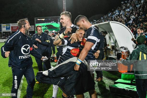 Agen's head coach Stephane Prosper Agen's South African scrumhalf Enrico Januarie and Agen's French lock Corentin Braendlin winning the French Top 14...