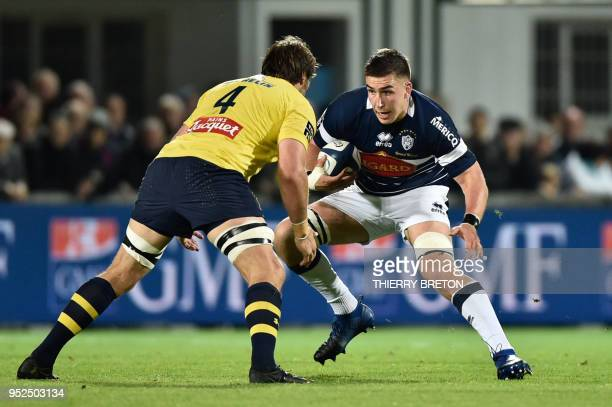 Agen's lock Corentin Braedlin challenges Clermont's South African lock Flip Van der Merwe during the French Top 14 rugby union match between SU Agen...