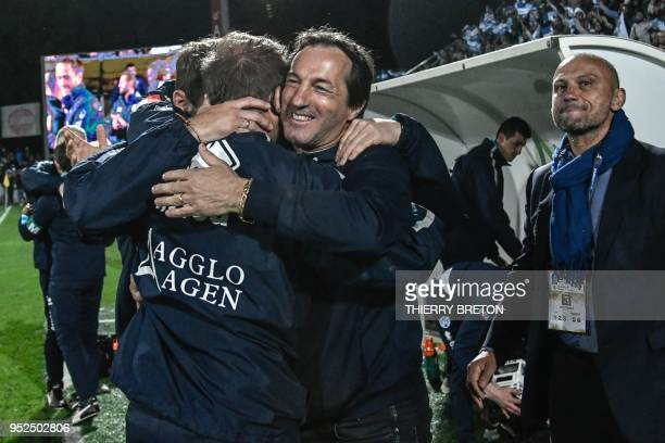 Agen's manager Philippe Sella celebrates with other staff members winning the French Top 14 rugby union match between SU Agen and ASM Clermont on...